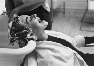 Audrey Hepburn Getting Shampooed And Laughing C7_18. Published In LIFE In 1953, Mark Shaw's Photo Of Audrey Hepburn Shows Her Being Shampooed On The Set Of Sabrina. The Source For This Image Was A Vintage 35mm Black And White Negative.