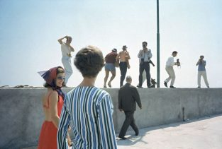 """Jackie With Papparazzi. Jackie Kennedy And Mark Shaw Often Vacationed In The Same Places; Here Jackie And Marella Agnelli (The Wife Of Fiat Magnate Gianni) Are Photographed In 1962 Being Followed By Paparazzi In Ravello, Italy. Jackie Was Photographed By Mark Wearing Her """"futuristic"""" Renauld Of France Sunglasses. She Is Quoted As Saying, """"That's Why I Always Wear My Dark Glasses. It May Be That They're (the Public) Looking At Me, But None Of Them Can Ever Tell Which Ones I'm Looking Back At. That Way I Can Have Fun With It!"""" The Source For This Image Was A Vintage 35mm Color Transparency."""
