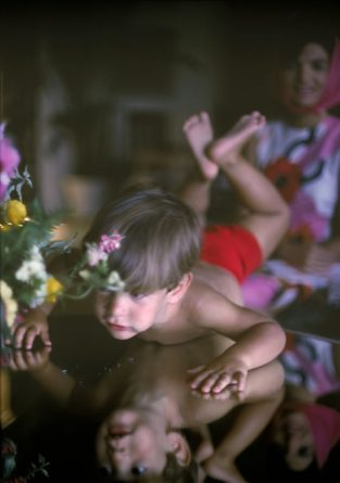 "This Photo Of John Junior, Taken When He Was Three, Was A Favorite Of Jackie's; In A Letter To Mark, Jackie Wrote ""they Really Should Be In The National Gallery!… The One Of John, Reflected In The Table, Like Some Wonderful, Strange, Poetic Matisse."" The Source For This Image Was A Vintage 35mm Color Transparency."