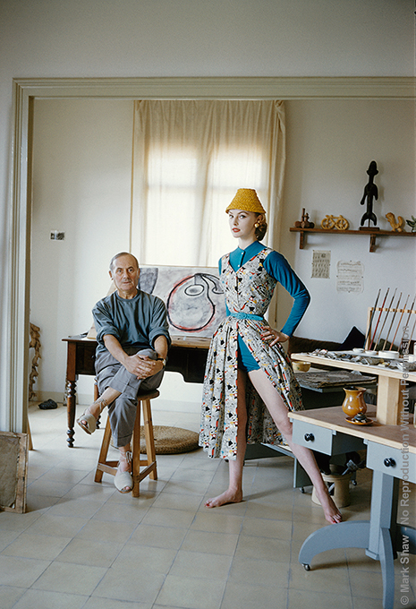 "Miro with Margaret Philipps, 1955. Joan Miro with model Margaret Philipps, photographed for LIFE magazine in his tiny studio in Barcelona by Mark Shaw in 1955. Miro's ""in progress"" work sits around him. The source for this image was a vintage 35mm color transparency."