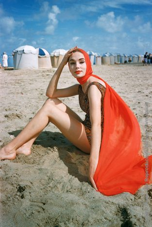 Orange Scarf On Beach At Trouville, 1957. A Model On The Beach At Trouville Near Deauville, Photographed By Mark Shaw For LIFE For The January 14, 1957 Issue. The Source For This Image Was A Vintage 35mm Color Transparency.