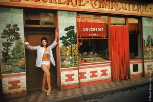 Christine Visits The Boucherie In St. Tropez 1961. Photographed By Mark Shaw For The Jan. 13, 1961 Issue Of LIFE, Model Christine Mayer Wears An Embroidered Bikini While Visiting A Boucherie In St. Tropez . The Source For This Image Was A Vintage 35mm Color Transparency.