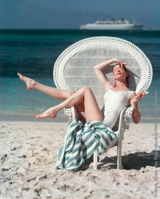 "Beach White Chair. A Classic 1950s Beach Image Photographed By Mark Shaw For Mademoiselle. The Source For This Image Was A 4"" X 5"" Vintage Color Transparency."