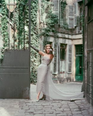 "Courtyard Dior Gray Chiffon. Dorothy Tristan In Dior's Soiree Etoilee Smash Hit Gray Chiffon Evening Dress. Photographed In A Paris Courtyard For The September 1955 Issue Of Life. The Source For This Image Was A 4"" X 5"" Vintage Color Transparency."
