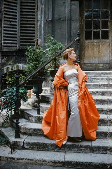 Courtyard Givenchy Rust Cape. Givenchy dress and cape. Photographed in a Paris courtyard for the September 1955 issue of LIFE magazine. The source for this image was a vintage 35mm color transparency.