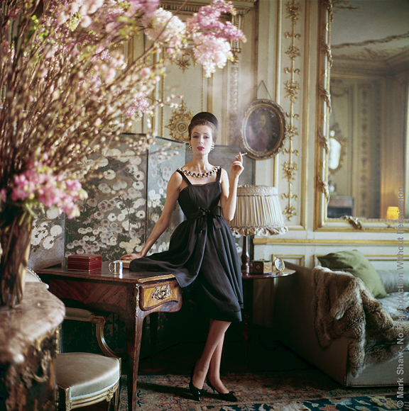 "Designer's Homes Smoking Black Dress, Dior, Paris, 1960. Gitta Schilling in a Dior gown photographed for LIFE in 1960. The ornate interior is the 17th century home of Suzanne Luling, then directrice of Dior. The source for this image was a vintage 2.25"" x 2.25"" color transparency."