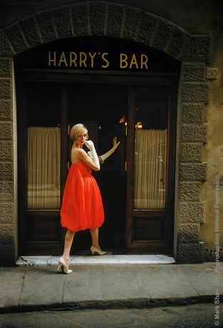 "Fabiani Bag Dress Outside Harry's Bar, Paris, 1957. A Model Wearing A Fabiani ""Bag"" Dress Is Photographed Outside Harry's Bar In Paris. Photographed In 1957 By Mark Shaw In Paris For LIFE Magazine's September Article ""A Bright Young Look In Paris"". The Source For This Image Was A Vintage 35mm Color Transparency."