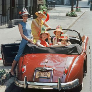 "Beach Hat Models In Red Jaguar. Photographed By Mark Shaw For LIFE's June 1959 Article ""Bedecked Beach Hats Hit The City"" This Image Shows Five Models Sporting An Array Of Amusingly Decorated Beach Hats. The Convertible Parked On A New York Side Street Is A Jaguar XK150DHC, 1957-61, The Last Of The Solid Rear Axle Sportsters. The Source For This Image Was A Vintage 2.25"" X 2.25"" Color Transparency."