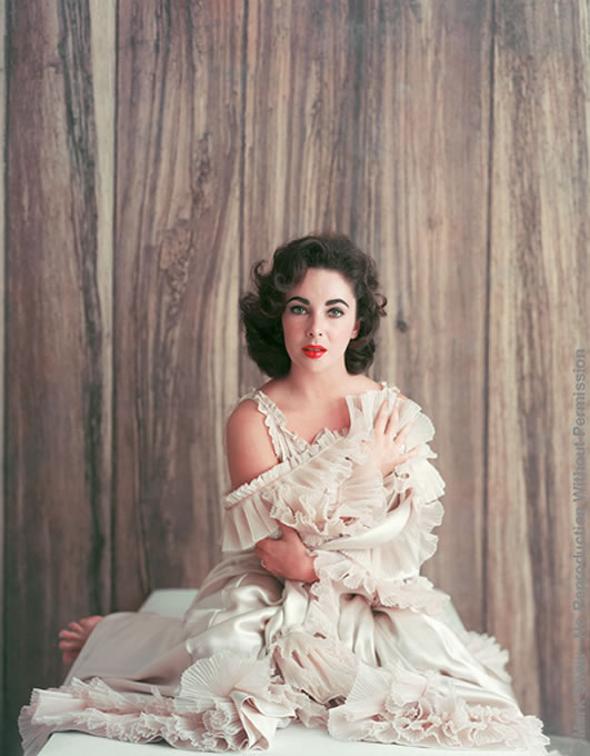 "Mark Shaw photographed Elizabeth Taylor for the October 15, 1956 cover of LIFE magazine. Taylor was starring in the academy award winning film, Giant, as Leslie Benedict, the matriarch of a Texas ranching family. The film also starred Rock Hudson and James Dean. Elizabeth Taylor is number seven on the American Film Institute's list of top 25 female legends. The source for this image was a vintage 8"" x 10"" color transparency."
