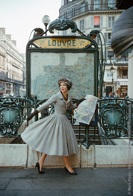 "Grey Dior Outside Paris Louvre Metro, 1957. This image of a model wearing a gray Dior suit outside the Louvre Metro station was photographed by Mark Shaw in Paris in 1957 for LIFE magazine's September article ""A Bright Young Look in Paris"". The source for this image was a vintage 35mm color transparency."