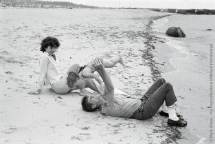 JFK Lifts Caroline On Beach, Forward