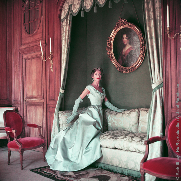 "Jane in Blue Fath on Daybed. Photographed in 1953 at the French country estate, Corbeville, Jane Sprague models a ball gown by Fath. The source of this image was a 2.25"" x 2.25"" vintage color transparency."
