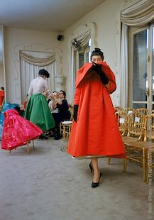 Balenciaga Orange Coat Front. Wearing A Balenciaga Orange Coat, A Model Poses For Buyers From I Magnin. Shot In 1953 And Published In The September 6, 1954 Issue Of LIFE. The Source For This Image Was A Vintage 35mm Color Transparency.