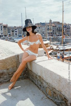 Christine Mayer St. Tropez Bikini Black Hat. Photographed For The January 1961 Issue Of LIFE, Christine Mayer Poses On The Jetty Overlooking St. Tropez Harbor Wearing The Year's Biggest Riviera Hit, An Embroidered Organdy Bikini Designed By Andejo Of Nice.The Source For This Image Was A Vintage 35mm Color Transparency.