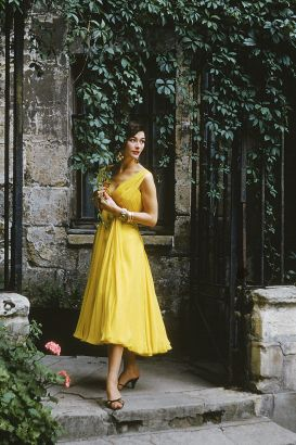 "Courtyard Desses Yellow Chiffon. ""High Waisted And Short- Skirted, This Chiffon Dress By Desses Is In The Closely Molded Directoire Style With Streamers Falling From The Bosom..."" Photographed In Paris For Life In 1955, The Model Is In Front Of A 200 Year Old House In The Passage Du Commerce-Saint-Andre. The Source For This Image Was A Vintage 35mm Color Transparency."