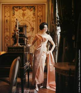 "Jacqueline De Ribes In Peach Dior Gown. In 1959 Mark Shaw Photographed The Vicomtesse Jacquline De Ribes Wearing Her Latest Dior Gown In The Paris Living Room Of Her Father-in-law's House. The Ankle Length Satin Gown Is Shown With A Matching Stole. A Variation Of This Image Appeared In The March 2, 1959 Life Article; ""Gala Evening Garb For Elegant Continentals."" The Source For This Image Was A Vintage 2.25"" X 2.25"" Color Transparency."