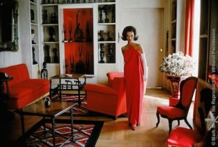 "Socialite Lee Radziwill, Red Gown In Red Room. Photographed By Mark Shaw In The 1960's, Socialite Lee Radziwill, Younger Sister Of Jacqueline Kennedy Is Considered A Great Style Icon. McCall's November 1962 Issue Quotes Radziwill As Saying ""A Tall Person Might Choose This Slender Red Crepe By Castillo At Lanvin. It Is Enveloped By One Large Panel, Knotted Together At The Strapless Top."" Radziwill Continues To Be Frequently Photographed Even Today. Radziwill's Former Palatial Homes In England Were Decorated By The Late Renzo Mongiardino. The Source For This Image Was A Vintage 35mm Color Transparency."