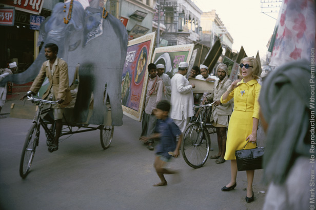 Tiger Morse in Yellow Suit, Street 01, 1962. The source for this image was a vintage 35mm color transparency.