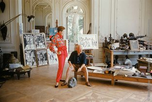 Picasso With Bettina And Skull. Photographed For LIFE In 1955 In His New Cannes Villa, La Californie, Picasso Celebrates His Fashion Debut By Clowning Around With A Skull. Top French Model, Bettina Graziani Wears An Outfit By American Fashion Designer Claire McCardell. The Shirt's Pattern Is In The Style Of A Picasso Still Life. All The Picasso Paintings Pictured Had Been Completed Within The Past Few Months. The Source For This Image Was A Vintage 35mm Color Transparency.