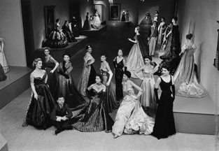Photographed By Mark Shaw For The Nov. 22, 1954 Issue Of LIFE, 29 Year Old Fashion Designer James Galanos Is Pictured In The Costume Institute Of The Metropolitan Museum Surrounded By Live Models Wearing His Designs. Background Mannequins Are Clothed In Vintage Fashions Up To 150 Years Old. The Source For This Image Was A Vintage 35mm Black And White Negative.